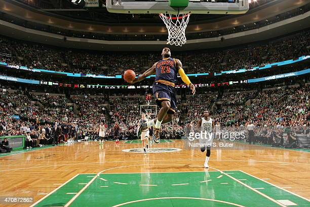 LeBron James of the Cleveland Cavaliers goes up for a dunk against the Boston Celtics during Game Three of the Eastern Conference Quarterfinals of...