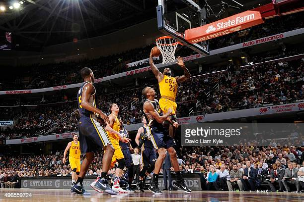 LeBron James of the Cleveland Cavaliers goes up for a dunk against the Utah Jazz on November 10 2015 at Quicken Loans Arena in Cleveland Ohio NOTE TO...