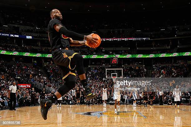 LeBron James of the Cleveland Cavaliers goes up for a dunk against the Denver Nuggets at Pepsi Center on December 29 2015 in Denver Colorado The...