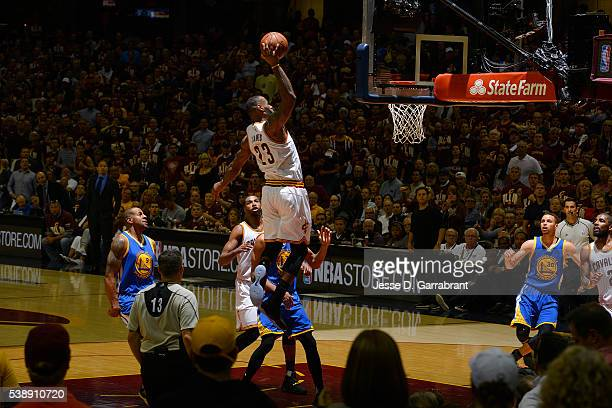 LeBron James of the Cleveland Cavaliers goes up for a dunk against the Golden State Warriors against the Golden State Warriors in Game Three of the...