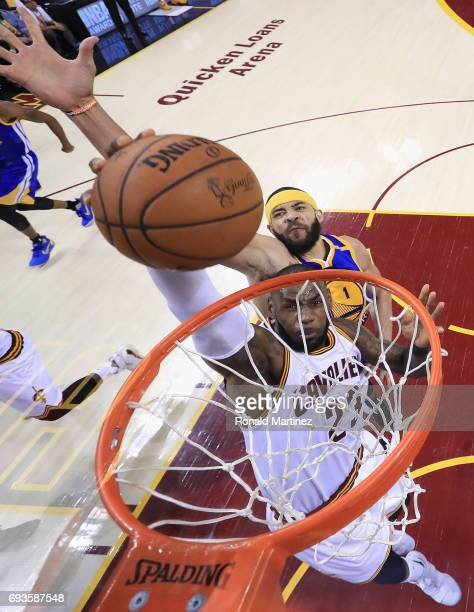 LeBron James of the Cleveland Cavaliers goes up for a dunk against JaVale McGee of the Golden State Warriors in the first half in Game 3 of the 2017...