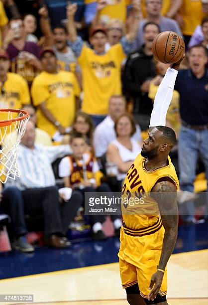 LeBron James of the Cleveland Cavaliers goes up for a dunk in the first quarter against the Atlanta Hawks during Game Four of the Eastern Conference...