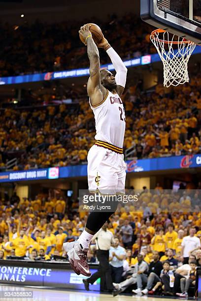 LeBron James of the Cleveland Cavaliers goes up for a dunk in the third quarter against the Toronto Raptors in game five of the Eastern Conference...