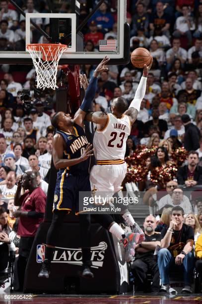 LeBron James of the Cleveland Cavaliers goes up for a shot against CJ Miles of the Indiana Pacers during Game Two of the Eastern Conference...