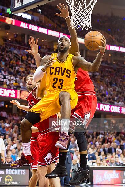 LeBron James of the Cleveland Cavaliers goes up for a shot against Pau Gasol and Jimmy Butler of the Chicago Bulls in the first half during Game Two...