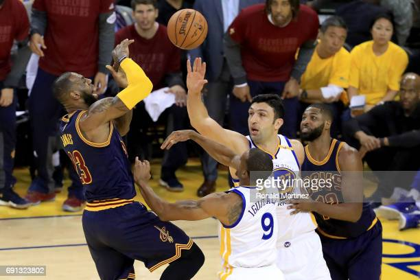 LeBron James of the Cleveland Cavaliers goes up for a shot against Zaza Pachulia and Andre Iguodala of the Golden State Warriors in Game 1 of the...