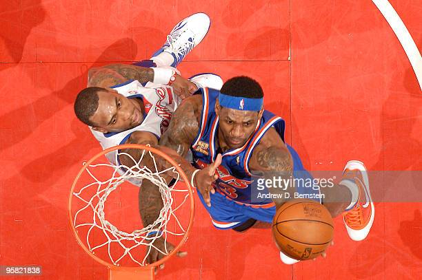 LeBron James of the Cleveland Cavaliers goes up for a shot against Rasual Butler of the Los Angeles Clippers at Staples Center on January 16 2010 in...