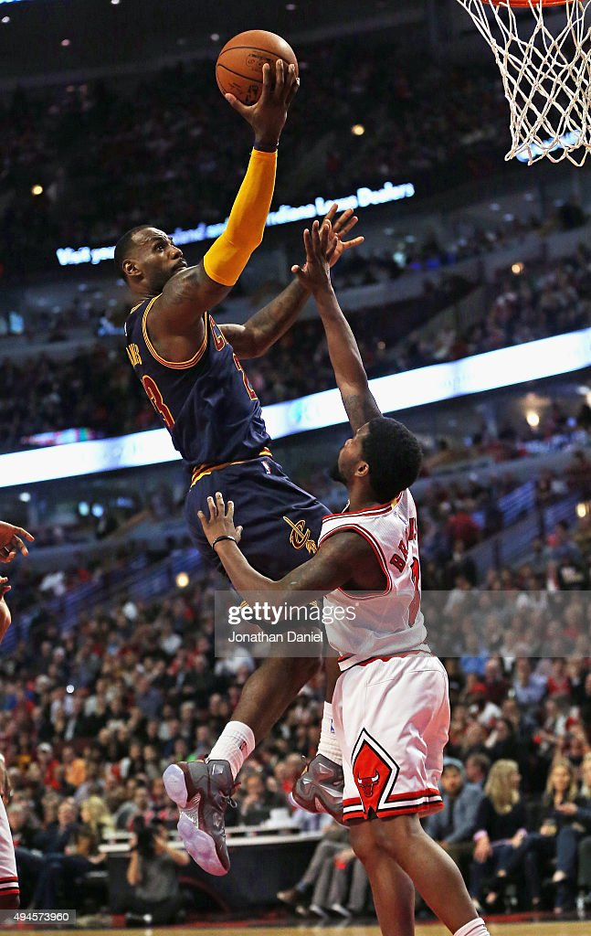 LeBron James #23 of the Cleveland Cavaliers goes up for a shot over Aaron Brooks #0 of the Chicago Bulls during the season opening game at the United Center on October 27, 2015 in Chicago, Illinois. Note to User: User expressly acknowledges and agrees that, by downloading and or using the photograph, User is consenting to the terms and conditions of the Getty Images License Agreement.