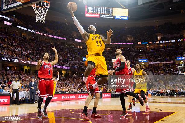 LeBron James of the Cleveland Cavaliers goes up for a shot over Derrick Rose and Taj Gibson of the Chicago Bulls in the first half during Game Two in...