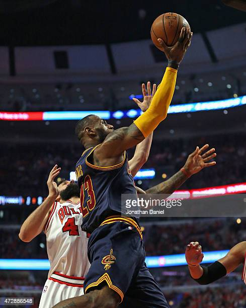 LeBron James of the Cleveland Cavaliers goes up for a shot past Nikola Mirotic of the Chicago Bulls n Game Four of the Eastern Conference Semifinals...