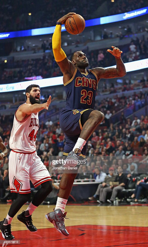 <a gi-track='captionPersonalityLinkClicked' href=/galleries/search?phrase=LeBron+James&family=editorial&specificpeople=201474 ng-click='$event.stopPropagation()'>LeBron James</a> #23 of the Cleveland Cavaliers goes up for a shot past Nikola Mirotic #44 of the Chicago Bulls during the season opening game at the United Center on October 27, 2015 in Chicago, Illinois. Note to User: User expressly acknowledges and agrees that, by downloading and or using the photograph, User is consenting to the terms and conditions of the Getty Images License Agreement.