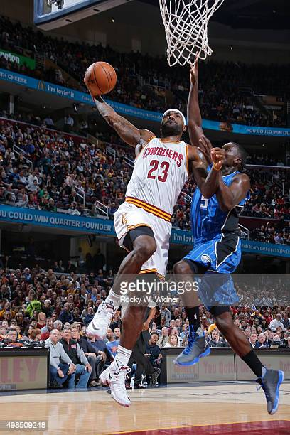 LeBron James of the Cleveland Cavaliers goes up for the dunk against Victor Oladipo of the Orlando Magic on November 23 2015 at Quicken Loans Arena...