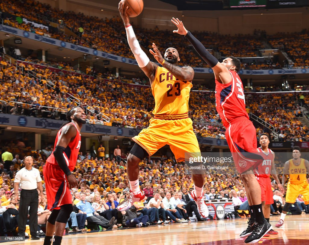 LeBron James of the Cleveland Cavaliers goes up for the layup against the Atlanta Hawks at the Quicken Loans Arena During Game Four of the Eastern...
