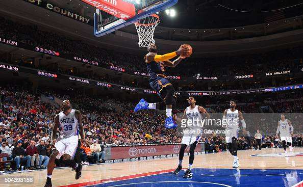 LeBron James of the Cleveland Cavaliers goes up for the reverse dunk against the Philadelphia 76ers at Wells Fargo Center on January 10 2015 in...