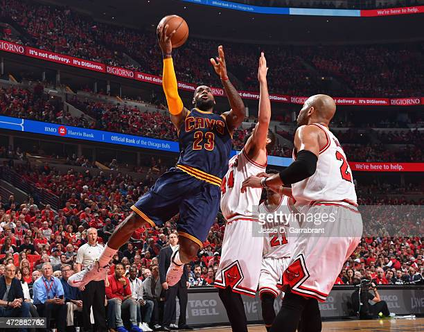 LeBron James of the Cleveland Cavaliers goes up for the shot against the Chicago Bulls at the United Center During Game Four of the Eastern...