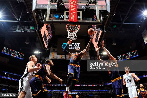 LeBron James of the Cleveland Cavaliers grabs a rebound against the San Antonio Spurs during the game on March 27 2017 at the ATT Center in San...