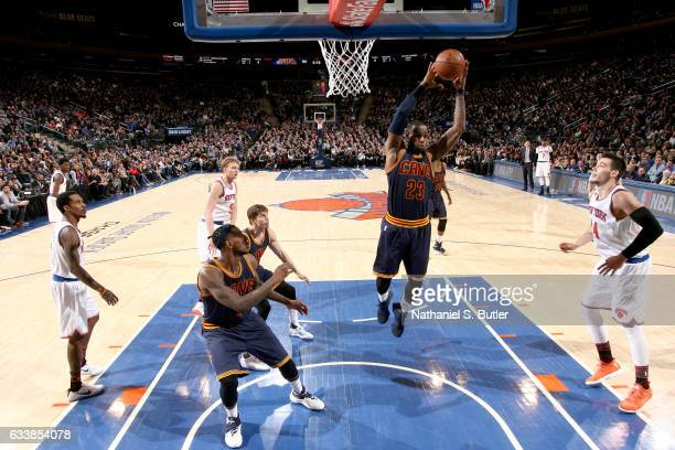 LeBron James of the Cleveland Cavaliers grabs the rebound against the New York Knicks on February 4 2017 at Madison Square Garden in New York City...