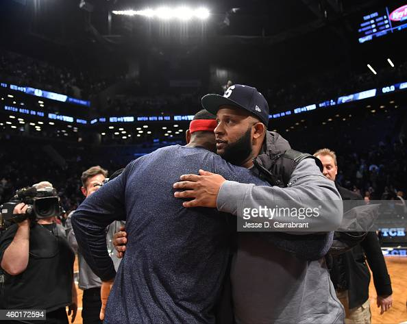 LeBron James of the Cleveland Cavaliers greets CC Sabathia of the New York Yankees after the game against the Brooklyn Nets at the Barclays Center on...