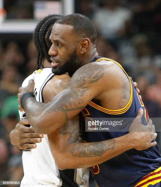 LeBron James of the Cleveland Cavaliers greets Kawhi Leonard of the San Antonio Spurs before the start of the game at ATT Center on March 27 2017 in...