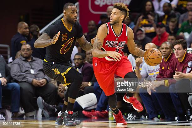 LeBron James of the Cleveland Cavaliers guards Allen Crabbe of the Portland Trail Blazers during the second half at Quicken Loans Arena on December 8...