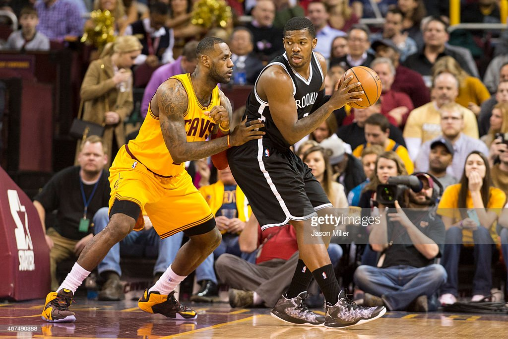 LeBron James of the Cleveland Cavaliers guards Joe Johnson of the Brooklyn Nets during the first half at Quicken Loans Arena on March 18 2015 in...