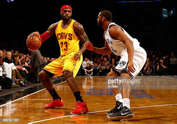 LeBron James of the Cleveland Cavaliers handles the ball against Alan Anderson of the Brooklyn Nets during their game at Barclays Center on December...