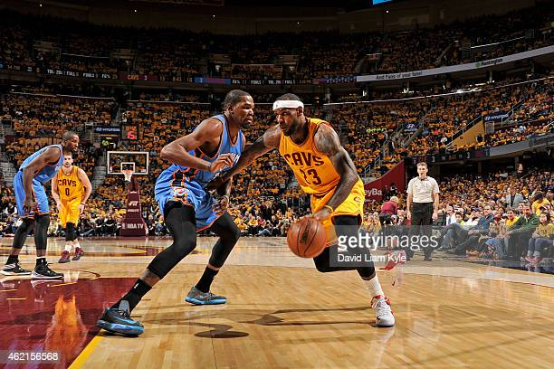 LeBron James of the Cleveland Cavaliers handles the ball against Kevin Durant of the Oklahoma City Thunder during the game on January 25 2015 at...