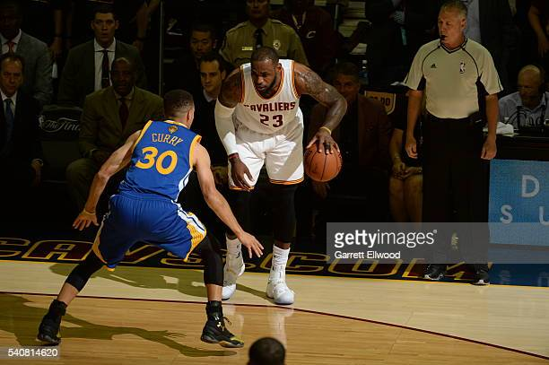 LeBron James of the Cleveland Cavaliers handles the ball against Stephen Curry of the Golden State Warriors in Game Six of the 2015 NBA Finals on...
