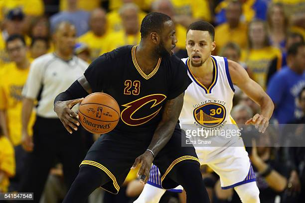 LeBron James of the Cleveland Cavaliers handles the ball against Stephen Curry of the Golden State Warriors during the second half in Game 7 of the...