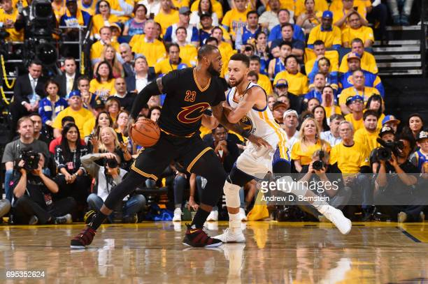 LeBron James of the Cleveland Cavaliers handles the ball against Stephen Curry of the Golden State Warriors in Game Five of the 2017 NBA Finals on...
