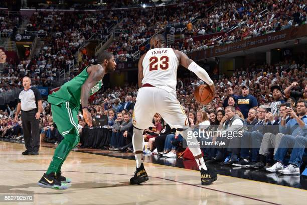 LeBron James of the Cleveland Cavaliers handles the ball against Kyrie Irving of the Boston Celtics on October 17 2017 at Quicken Loans Arena in...
