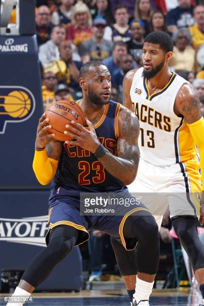 LeBron James of the Cleveland Cavaliers handles the ball against Paul George of the Indiana Pacers in the first half of Game Four of the Eastern...