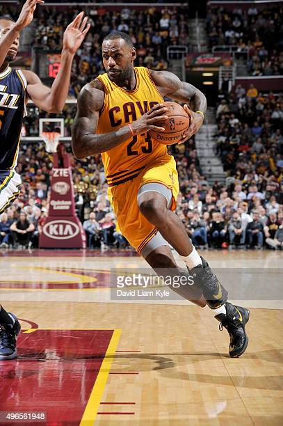 LeBron James of the Cleveland Cavaliers handles the ball against the Utah Jazz on November 10 2015 at Quicken Loans Arena in Cleveland Ohio NOTE TO...