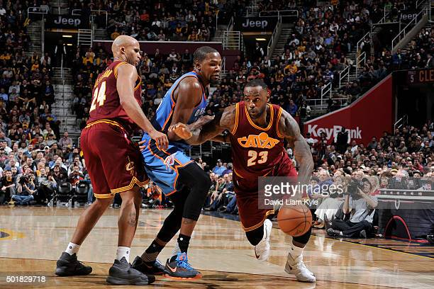 LeBron James of the Cleveland Cavaliers handles the ball against the Oklahoma City Thunder on December 17 2015 at The Quicken Loans Arena in...