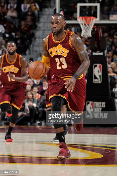 LeBron James of the Cleveland Cavaliers handles the ball against the New York Knicks on February 23 2017 at Quicken Loans Arena in Cleveland Ohio...