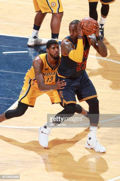 LeBron James of the Cleveland Cavaliers handles the ball against the Indiana Pacers during Game Three of the Eastern Conference Quarterfinals of the...