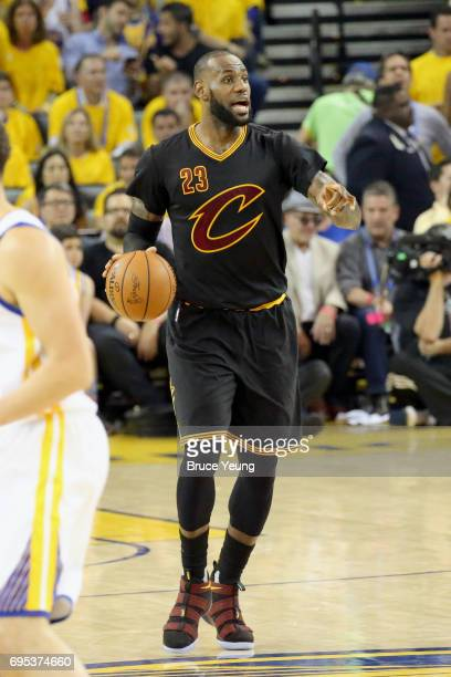 LeBron James of the Cleveland Cavaliers handles the ball against the Golden State Warriors in Game Five of the 2017 NBA Finals on June 12 2017 at...