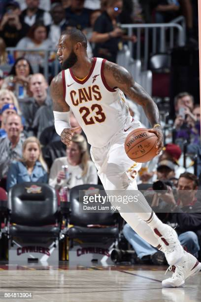 LeBron James of the Cleveland Cavaliers handles the ball against the Orlando Magic on October 21 2017 at Quicken Loans Arena in Cleveland Ohio NOTE...