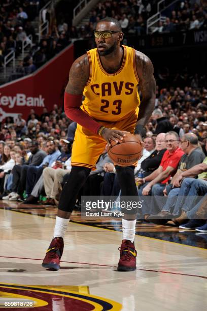 LeBron James of the Cleveland Cavaliers handles the ball during a game against the Washington Wizards on March 25 2017 at Quicken Loans Arena in...