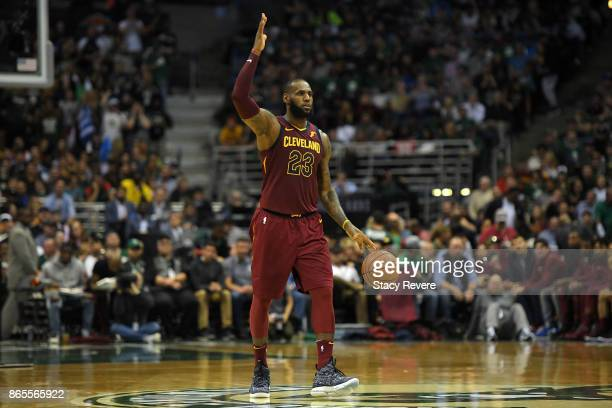 LeBron James of the Cleveland Cavaliers handles the ball during a game against the Milwaukee Bucks at the Bradley Center on October 20 2017 in...