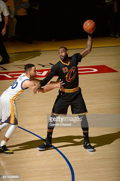 LeBron James of the Cleveland Cavaliers handles the ball during the game against Stephen Curry of the Golden State Warriors during the 2016 NBA...