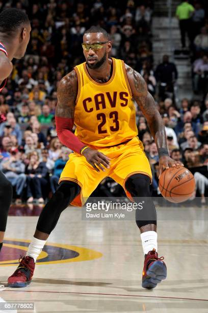 LeBron James of the Cleveland Cavaliers handles the ball during the game against the Washington Wizards on March 25 2017 at Quicken Loans Arena in...
