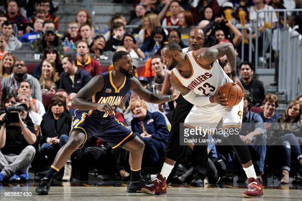 LeBron James of the Cleveland Cavaliers handles the ball during the game against Lance Stephenson of the Indiana Pacers on April 2 2017 at Quicken...