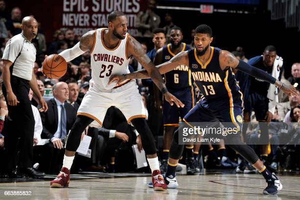 LeBron James of the Cleveland Cavaliers handles the ball during the game against Paul George of the Indiana Pacers on April 2 2017 at Quicken Loans...