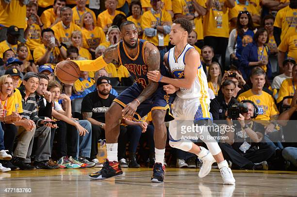 LeBron James of the Cleveland Cavaliers handles the basketball against Stephen Curry of the Golden State Warriors during Game Five of the 2015 NBA...