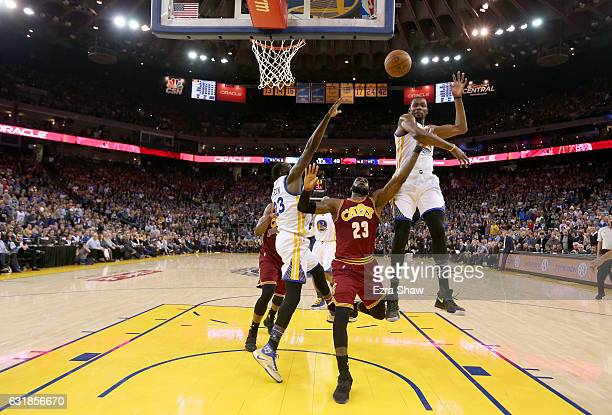 LeBron James of the Cleveland Cavaliers has a shot blocked by Kevin Durant of the Golden State Warriors at ORACLE Arena on January 16 2017 in Oakland...