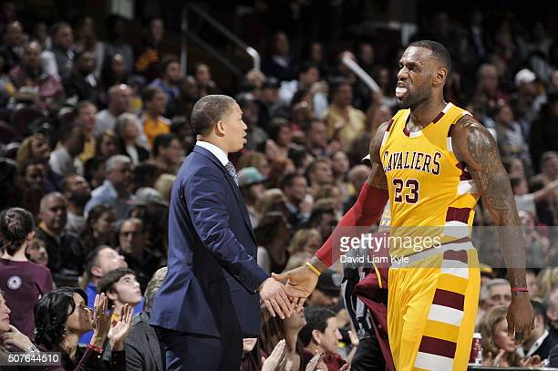 LeBron James of the Cleveland Cavaliers high fives Head Coach Tyronn Lue during the game against the San Antonio Spurs on January 30 2016 at Quicken...