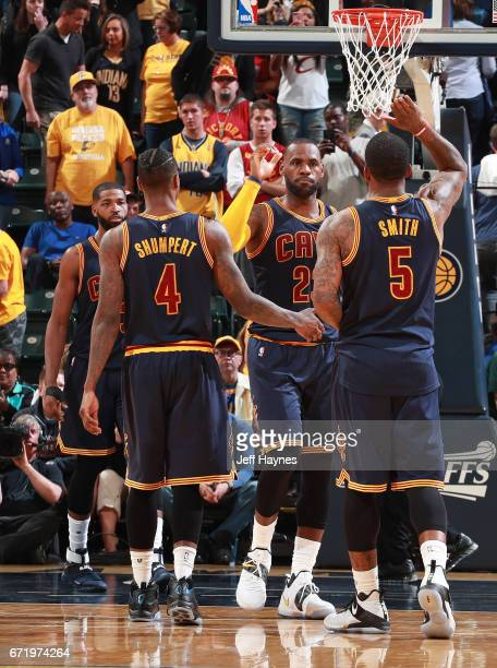 LeBron James of the Cleveland Cavaliers high fives teammates during the game against the Indiana Pacers during Game Four of the Eastern Conference...