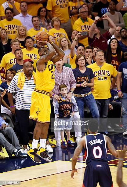 LeBron James of the Cleveland Cavaliers hits a three pointer to take the lead in overtime against the Atlanta Hawks during Game Three of the Eastern...