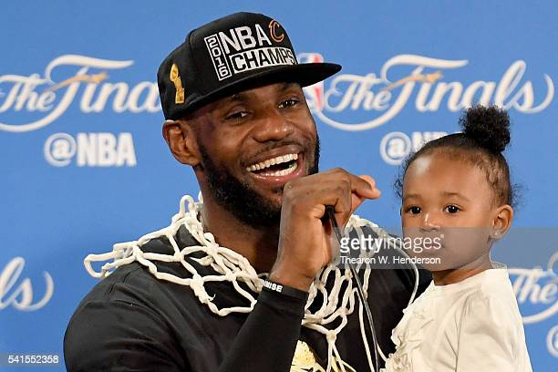 LeBron James of the Cleveland Cavaliers holds his daughter Zhuri during a press conference after defeating the Golden State Warriors 9389 in Game 7...